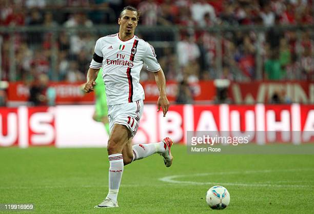 Zlatan Ibrahimovic of Milan runs with the ball during the Audi Cup match between FC Bayern Muenchen and AC Milan at Allianz Arena on July 26 2011 in...