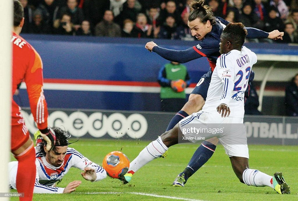<a gi-track='captionPersonalityLinkClicked' href=/galleries/search?phrase=Zlatan+Ibrahimovic&family=editorial&specificpeople=206139 ng-click='$event.stopPropagation()'>Zlatan Ibrahimovic</a> of Paris Saint-Germain and <a gi-track='captionPersonalityLinkClicked' href=/galleries/search?phrase=Milan+Bisevac&family=editorial&specificpeople=600075 ng-click='$event.stopPropagation()'>Milan Bisevac</a>, Samuel Um Titi of Olympique Lyonnais during the French Ligue 1 between Paris Saint-Germain FC and Olympique Lyonnais at Parc Des Princes on December 1, 2013 in Paris, France.