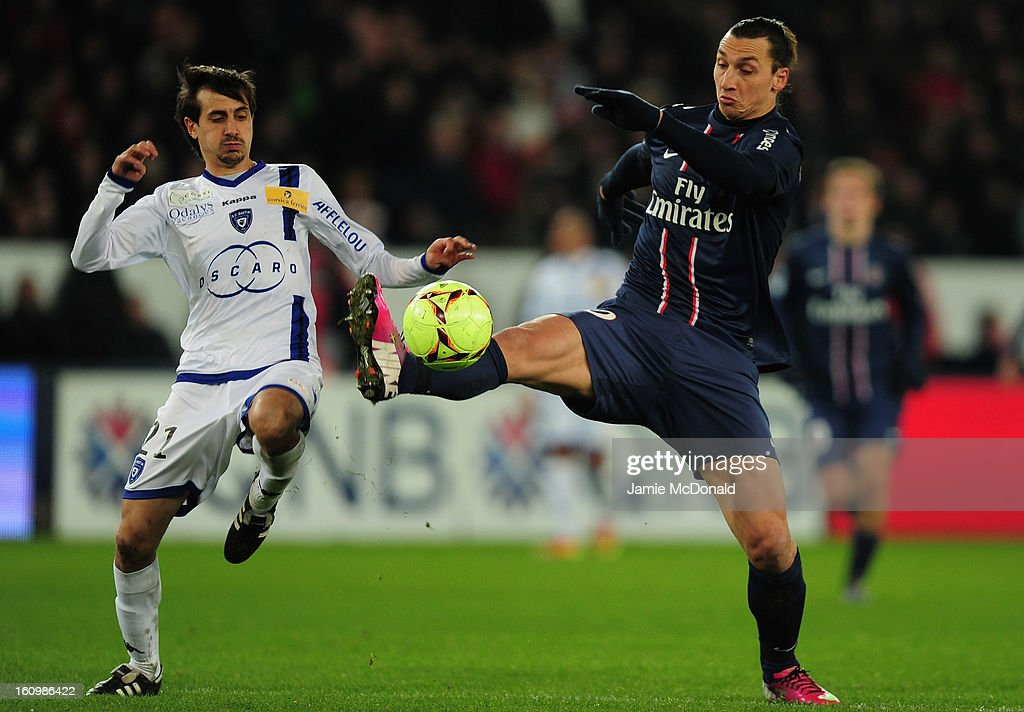 Zlatan Ibrahimovic of Paris Saint-Germain battles with Fethi Harek of SC Bastia during the Ligue 1 match between Paris Saint-Germain FC and SC Bastia at Parc des Princes on February 8, 2013 in Paris, France.