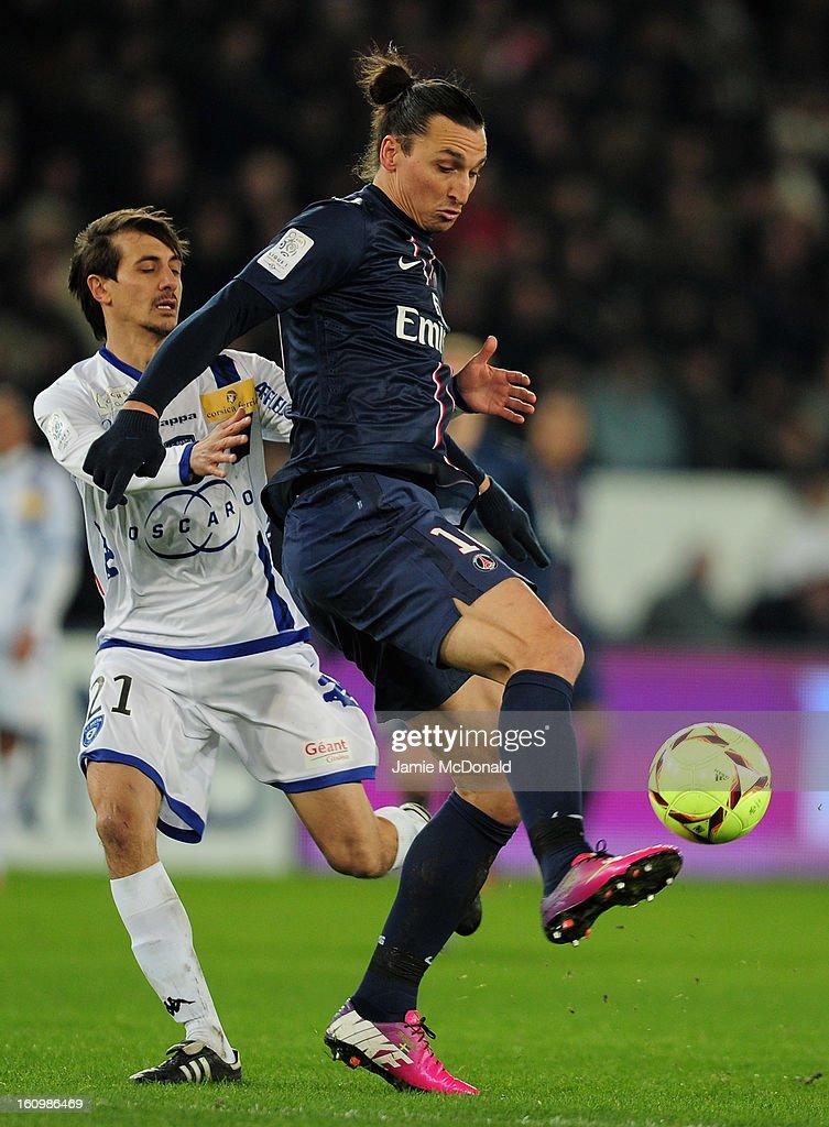 Zlatan Ibrahimovic of Paris SaintGermain battles with Fethi Harek of SC Bastia during the Ligue 1 match between Paris SaintGermain FC and SC Bastia...