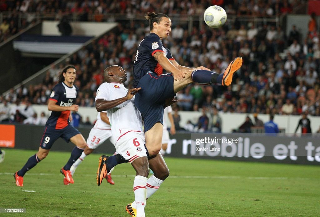 <a gi-track='captionPersonalityLinkClicked' href=/galleries/search?phrase=Zlatan+Ibrahimovic&family=editorial&specificpeople=206139 ng-click='$event.stopPropagation()'>Zlatan Ibrahimovic</a> of Paris Saint-Germain catch the ball with <a gi-track='captionPersonalityLinkClicked' href=/galleries/search?phrase=Ronald+Zubar&family=editorial&specificpeople=1295892 ng-click='$event.stopPropagation()'>Ronald Zubar</a> (L) of Ajaccio AC during the French League 1 between Paris Saint-Germain FC and AC Ajaccio, at Parc des Princes on August 18, 2013 in Paris, France.
