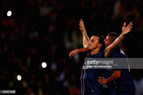 Zlatan Ibrahimovic of Paris SaintGermain celebrates scoring the first goal of the game during the UEFA Champions League match between Paris...