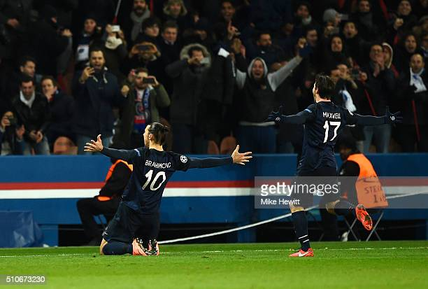Zlatan Ibrahimovic of Paris SaintGermain celebrates with Maxwell as he scores their first goal from a free kick during the UEFA Champions League...