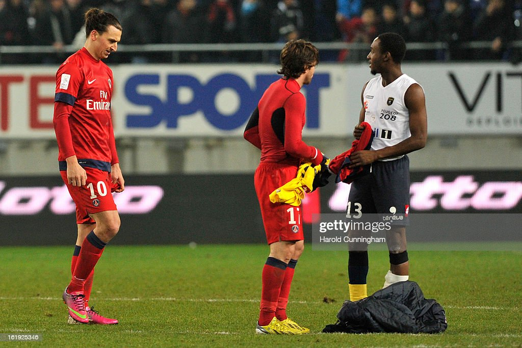Zlatan Ibrahimovic of Paris Saint-Germain FC looks dejected as Maxwell of Paris Saint-Germain FC and Giovanni Sio of FC Sochaux-Montbeliard exchange their jersey after the French League 1 football match between FC Sochaux-Montbeliard and Paris Saint-Germain FC at Stade Auguste Bonal on February 17, 2013 in Montbeliard, France.