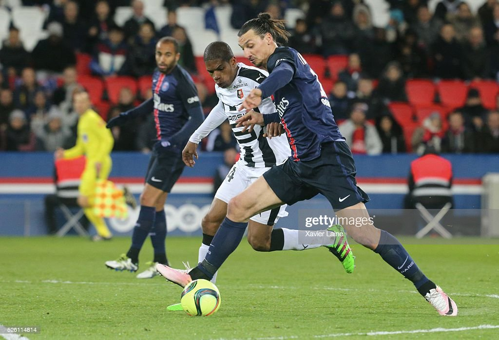 <a gi-track='captionPersonalityLinkClicked' href=/galleries/search?phrase=Zlatan+Ibrahimovic&family=editorial&specificpeople=206139 ng-click='$event.stopPropagation()'>Zlatan Ibrahimovic</a> of Paris Saint-Germain in action before his second goal with <a gi-track='captionPersonalityLinkClicked' href=/galleries/search?phrase=Ludovic+Baal&family=editorial&specificpeople=4820335 ng-click='$event.stopPropagation()'>Ludovic Baal</a> of Stade Rennais during the French Ligue 1 match between Paris Saint-Germain and Stade Rennais at Parc des Princes on april 29, 2016 in Paris, France.
