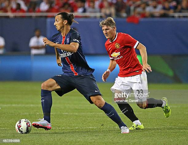Zlatan Ibrahimovic of Paris SaintGermain is chase by Bastain Schweinsteiger of Manchester United during a match in the 2015 International Champions...