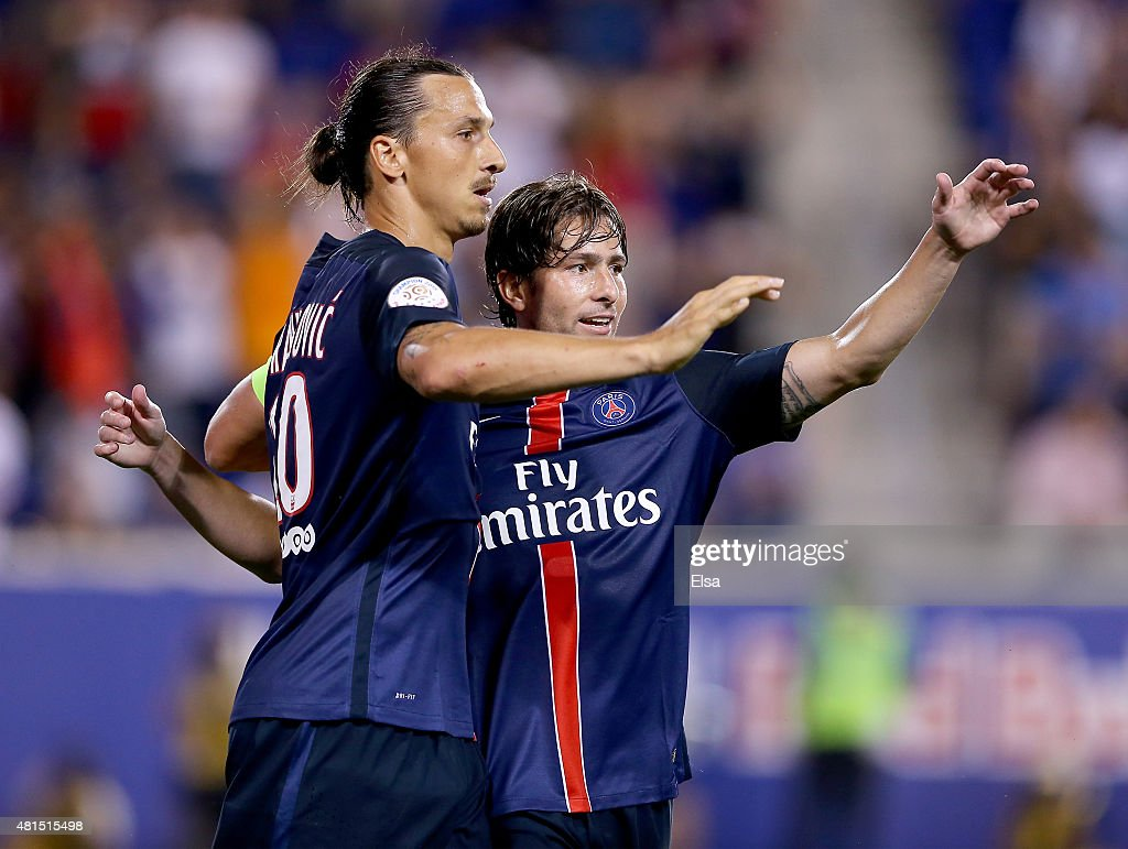 Zlatan Ibrahimovic #10 of Paris Saint-Germain is congratulated by teamamte Maxwell #17 after Ibrahimovic scored a goal in the second half against AFC Fiorentina during the International Champions Cup at Red Bull Arena on July 21, 2015 in Harrison, New Jersey.Paris Saint-Germain defeated ACF Fiorentina 4-2.
