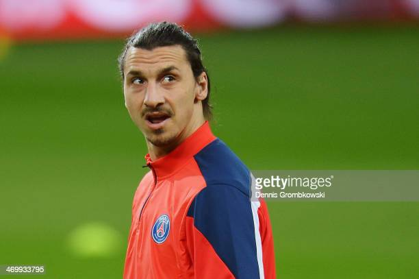 Zlatan Ibrahimovic of Paris SaintGermain looks on during a training session ahead of the UEFA Champions League match between Bayer Leverkusen and...