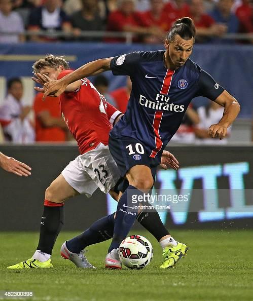 Zlatan Ibrahimovic of Paris SaintGermain moves around Bastain Schweinsteiger of Manchester United during a match in the 2015 International Champions...