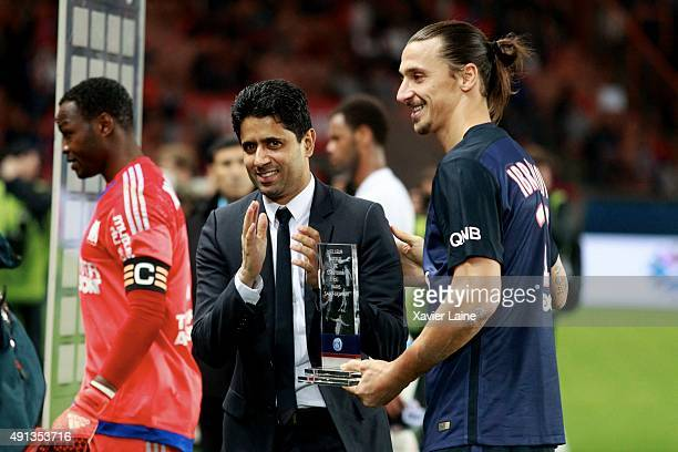 Zlatan Ibrahimovic of Paris SaintGermain receipt the MVP trophy by president Nasser AlKhelaifi during the French Ligue 1 between Paris SaintGermain...