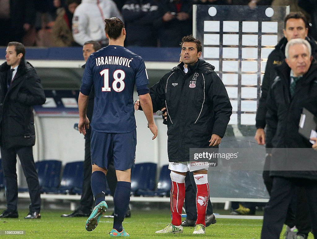 <a gi-track='captionPersonalityLinkClicked' href=/galleries/search?phrase=Zlatan+Ibrahimovic&family=editorial&specificpeople=206139 ng-click='$event.stopPropagation()'>Zlatan Ibrahimovic</a> of PSG and <a gi-track='captionPersonalityLinkClicked' href=/galleries/search?phrase=Adrian+Mutu&family=editorial&specificpeople=211247 ng-click='$event.stopPropagation()'>Adrian Mutu</a> of AC Ajaccio after the French Ligue 1 match between Paris Saint Germain FC and AC Ajaccio at the Parc des Princes stadium on January 11, 2013 in Paris, France.