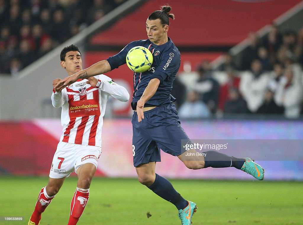Zlatan Ibrahimovic (R) of PSG and Benjamin Andre of AC Ajaccio in action during the French Ligue 1 match between Paris Saint Germain FC and AC Ajaccio at the Parc des Princes stadium on January 11, 2013 in Paris, France.