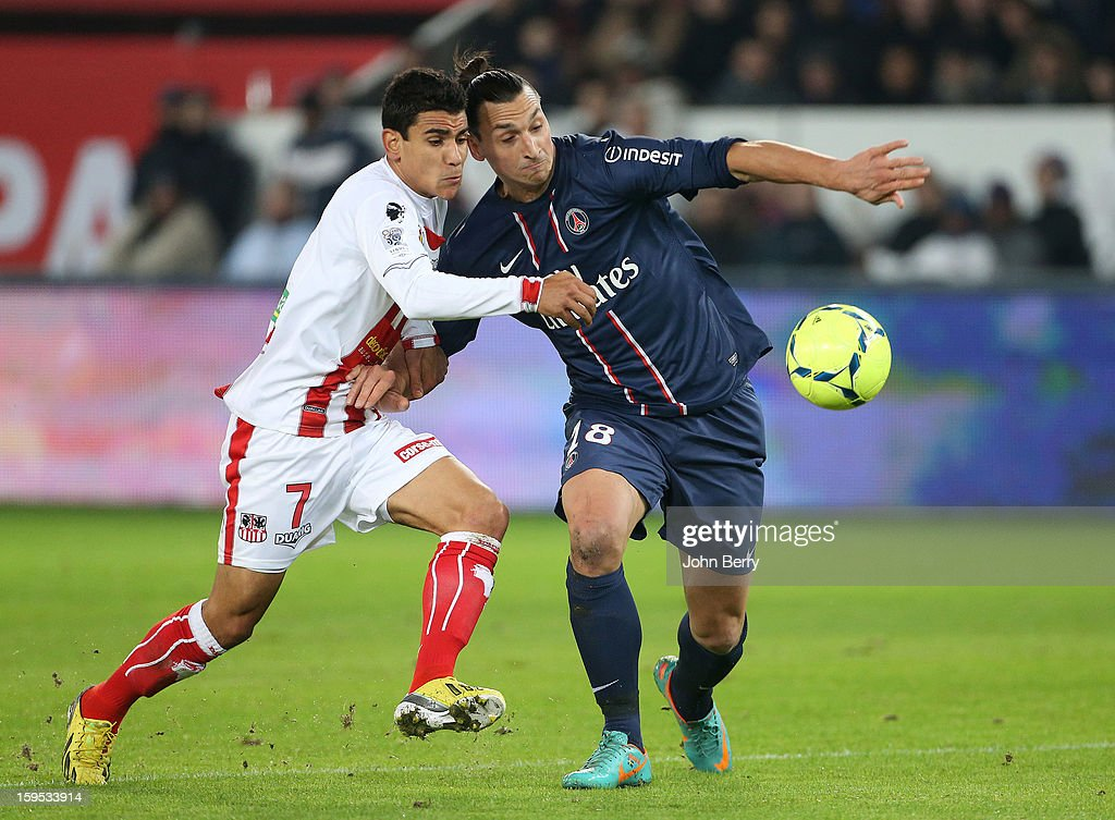 <a gi-track='captionPersonalityLinkClicked' href=/galleries/search?phrase=Zlatan+Ibrahimovic&family=editorial&specificpeople=206139 ng-click='$event.stopPropagation()'>Zlatan Ibrahimovic</a> (R) of PSG and Benjamin Andre of AC Ajaccio in action during the French Ligue 1 match between Paris Saint Germain FC and AC Ajaccio at the Parc des Princes stadium on January 11, 2013 in Paris, France.