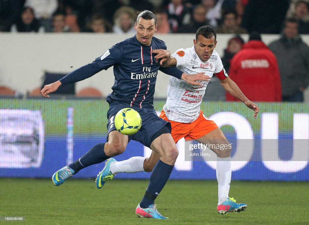 Zlatan Ibrahimovic of PSG and Hilton of Montpellier in action during the french Ligue 1 match between Paris Saint-Germain FC and Montpellier Herault SC at the Parc des Princes stadium on March 29, 2013 in Paris, France.