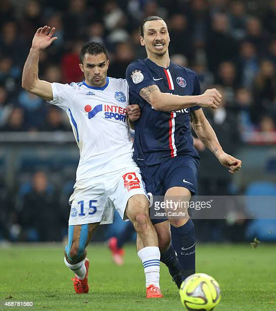 Zlatan Ibrahimovic of PSG and Jeremy Morel of OM in action during the French Ligue 1 match between Olympique de Marseille and Paris SaintGermain at...