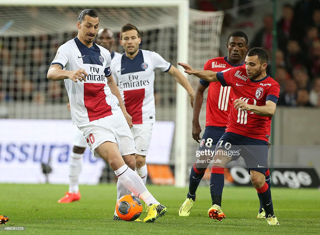 <a gi-track='captionPersonalityLinkClicked' href=/galleries/search?phrase=Zlatan+Ibrahimovic&family=editorial&specificpeople=206139 ng-click='$event.stopPropagation()'>Zlatan Ibrahimovic</a> of PSG and <a gi-track='captionPersonalityLinkClicked' href=/galleries/search?phrase=Marvin+Martin&family=editorial&specificpeople=5534442 ng-click='$event.stopPropagation()'>Marvin Martin</a> of Lille in action during the french Ligue 1 match between LOSC Lille and Paris Saint-Germain FC at the Grand Stade Pierre Mauroy on May 10, 2014 in Lille, France.