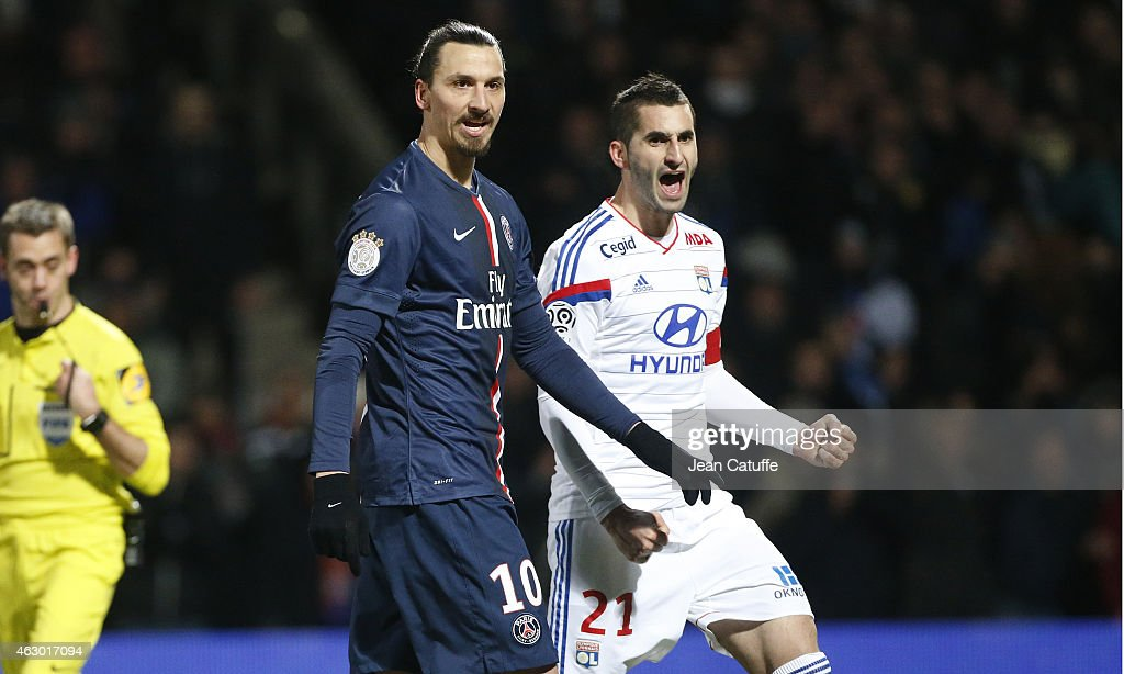 Zlatan Ibrahimovic of PSG and <a gi-track='captionPersonalityLinkClicked' href=/galleries/search?phrase=Maxime+Gonalons&family=editorial&specificpeople=6256905 ng-click='$event.stopPropagation()'>Maxime Gonalons</a> of Lyon react during the French Ligue 1 match between Olympique Lyonnais (OL) and Paris Saint-Germain FC (PSG) at Stade de Gerland on February 8, 2015 in Lyon, France.