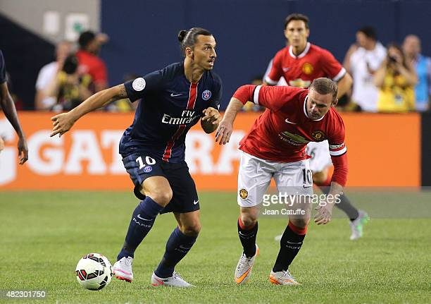 Zlatan Ibrahimovic of PSG and Wayne Rooney of Manchester United in action during the International Champions Cup 2015 game between Manchester United...