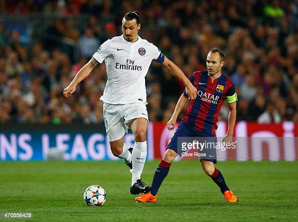 Zlatan Ibrahimovic of PSG beats Andres Iniesta of Barcelona during the UEFA Champions League Quarter Final second leg match between FC Barcelona and...