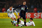 Zlatan Ibrahimovic of PSG beats Michel Lucas Mendes and Joey Barton of Marseille during the French Cup match between Paris SaintGermain FC and...