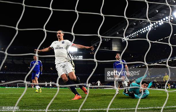 Zlatan Ibrahimovic of PSG celebrates after scoring his team's second goal past goalkeeper Thibaut Courtois of Chelsea during the UEFA Champions...