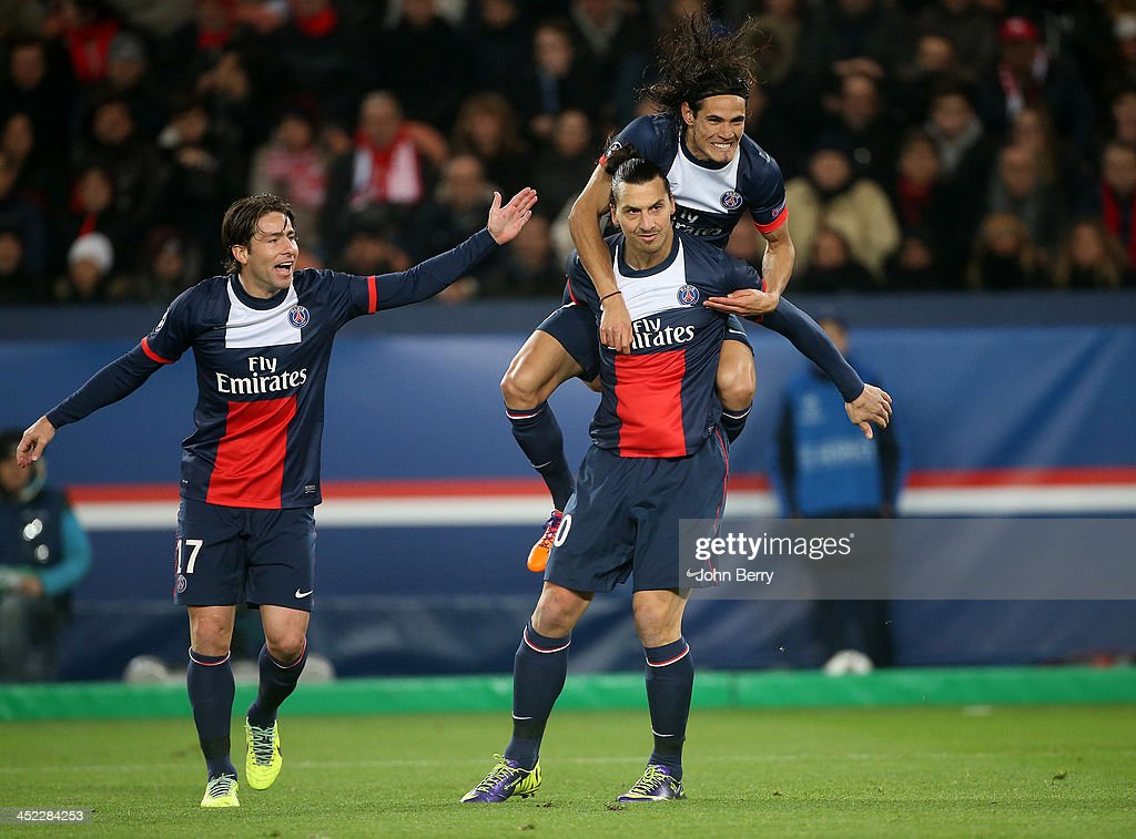 <a gi-track='captionPersonalityLinkClicked' href=/galleries/search?phrase=Zlatan+Ibrahimovic&family=editorial&specificpeople=206139 ng-click='$event.stopPropagation()'>Zlatan Ibrahimovic</a> of PSG celebrates his goal with teammates <a gi-track='captionPersonalityLinkClicked' href=/galleries/search?phrase=Edinson+Cavani&family=editorial&specificpeople=4104253 ng-click='$event.stopPropagation()'>Edinson Cavani</a> and Maxwell Scherrer (L) during the UEFA Champions League Group C match between Paris Saint-Germain FC and Olympiacos FC at the Parc des Princes stadium on November 27, 2013 in Paris, France.