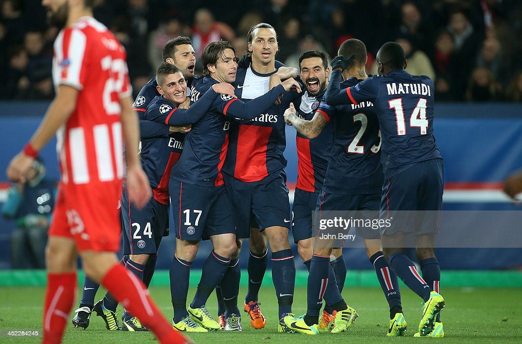 <a gi-track='captionPersonalityLinkClicked' href=/galleries/search?phrase=Zlatan+Ibrahimovic&family=editorial&specificpeople=206139 ng-click='$event.stopPropagation()'>Zlatan Ibrahimovic</a> of PSG celebrates his goal with teammates <a gi-track='captionPersonalityLinkClicked' href=/galleries/search?phrase=Thiago+Motta+-+Brazilian+Soccer+Player+-+Born+1982&family=editorial&specificpeople=631059 ng-click='$event.stopPropagation()'>Thiago Motta</a>, <a gi-track='captionPersonalityLinkClicked' href=/galleries/search?phrase=Marco+Verratti&family=editorial&specificpeople=7256509 ng-click='$event.stopPropagation()'>Marco Verratti</a>, Maxwell Scherrer, <a gi-track='captionPersonalityLinkClicked' href=/galleries/search?phrase=Ezequiel+Lavezzi&family=editorial&specificpeople=5451126 ng-click='$event.stopPropagation()'>Ezequiel Lavezzi</a>, <a gi-track='captionPersonalityLinkClicked' href=/galleries/search?phrase=Blaise+Matuidi&family=editorial&specificpeople=801779 ng-click='$event.stopPropagation()'>Blaise Matuidi</a> during the UEFA Champions League Group C match between Paris Saint-Germain FC and Olympiacos FC at the Parc des Princes stadium on November 27, 2013 in Paris, France.