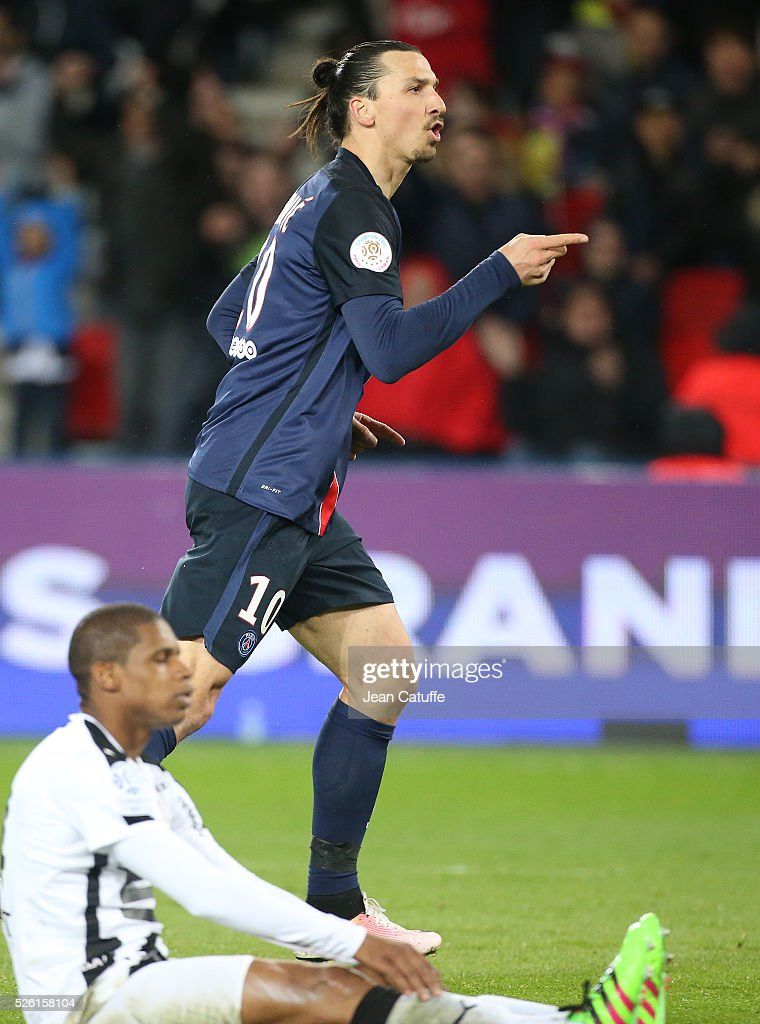 <a gi-track='captionPersonalityLinkClicked' href=/galleries/search?phrase=Zlatan+Ibrahimovic&family=editorial&specificpeople=206139 ng-click='$event.stopPropagation()'>Zlatan Ibrahimovic</a> of PSG celebrates his second goal while <a gi-track='captionPersonalityLinkClicked' href=/galleries/search?phrase=Ludovic+Baal&family=editorial&specificpeople=4820335 ng-click='$event.stopPropagation()'>Ludovic Baal</a> of Rennes looks on during the French Ligue 1 match between Paris Saint-Germain (PSG) and Stade Rennais FC at Parc des Princes stadium on April 29, 2016 in Paris, France.