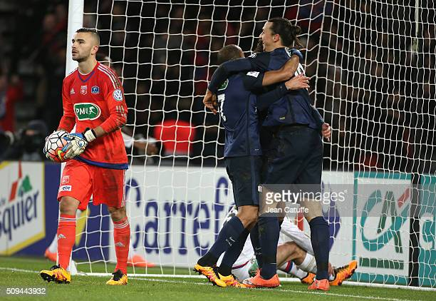 Zlatan Ibrahimovic of PSG celebrates scoring the first goal while goalkeeper of Lyon Anthony Lopes looks dejected during the French Cup match between...