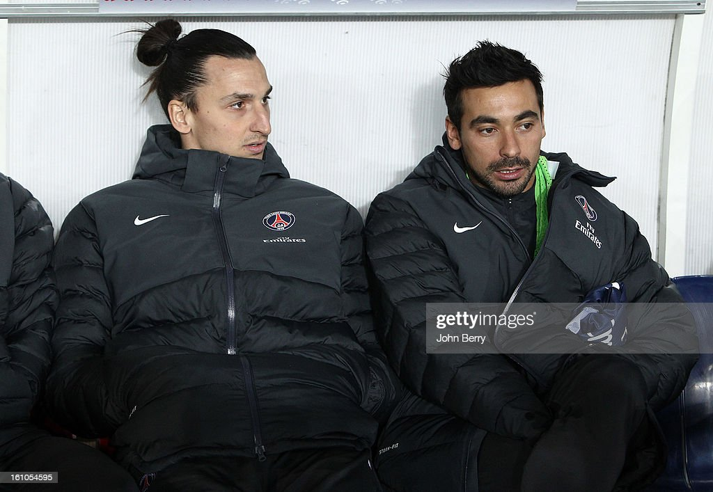 Zlatan Ibrahimovic of PSG chats with Ezequiel Lavezzi on the bench during the first half of the French Ligue 1 match between Paris Saint Germain FC and Sporting Club de Bastia at the Parc des Princes stadium on February 8, 2013 in Paris, France.