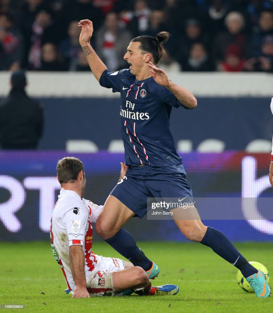 <a gi-track='captionPersonalityLinkClicked' href=/galleries/search?phrase=Zlatan+Ibrahimovic&family=editorial&specificpeople=206139 ng-click='$event.stopPropagation()'>Zlatan Ibrahimovic</a> of PSG gets tackled by Arnaud Maire of AC Ajaccio during the French Ligue 1 match between Paris Saint Germain FC and AC Ajaccio at the Parc des Princes stadium on January 11, 2013 in Paris, France.