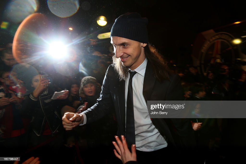 Zlatan Ibrahimovic of PSG greets fans as he arrives at the stadium ahead of the French Cup match between Paris Saint Germain FC and Olympique de Marseille OM at the Parc des Princes stadium on February 27, 2013 in Paris, France.