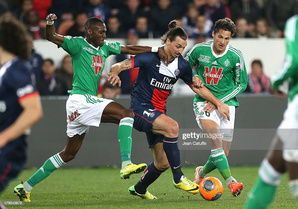 <a gi-track='captionPersonalityLinkClicked' href=/galleries/search?phrase=Zlatan+Ibrahimovic&family=editorial&specificpeople=206139 ng-click='$event.stopPropagation()'>Zlatan Ibrahimovic</a> of PSG in action between Josua Guilavogui and Jeremy Clement of Saint-Etienne during the Ligue 1 match between Paris Saint-Germain FC and AS Saint-Etienne at Parc des Princes stadium on March 16, 2014 in Paris, France.