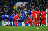 Zlatan Ibrahimovic of PSG is consoled by Cesc Fabregas of Chelsea after receiving a straight red card for his tackle on Oscar of Chelsea during the...
