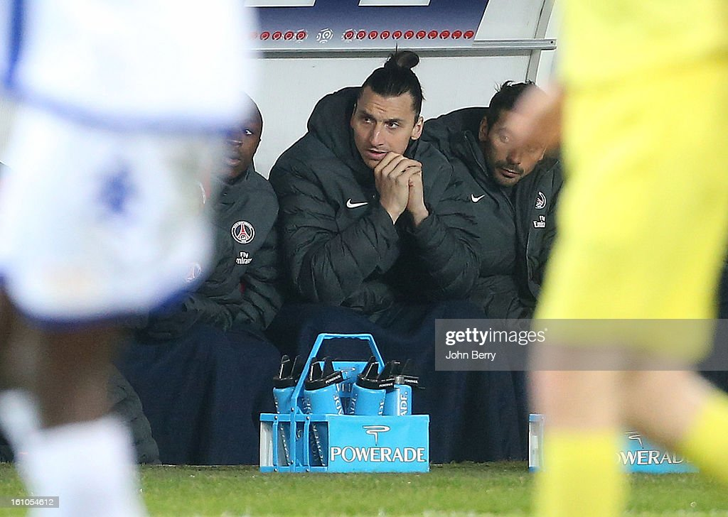 Zlatan Ibrahimovic of PSG looks on from the bench during the first half of the French Ligue 1 match between Paris Saint Germain FC and Sporting Club de Bastia at the Parc des Princes stadium on February 8, 2013 in Paris, France.