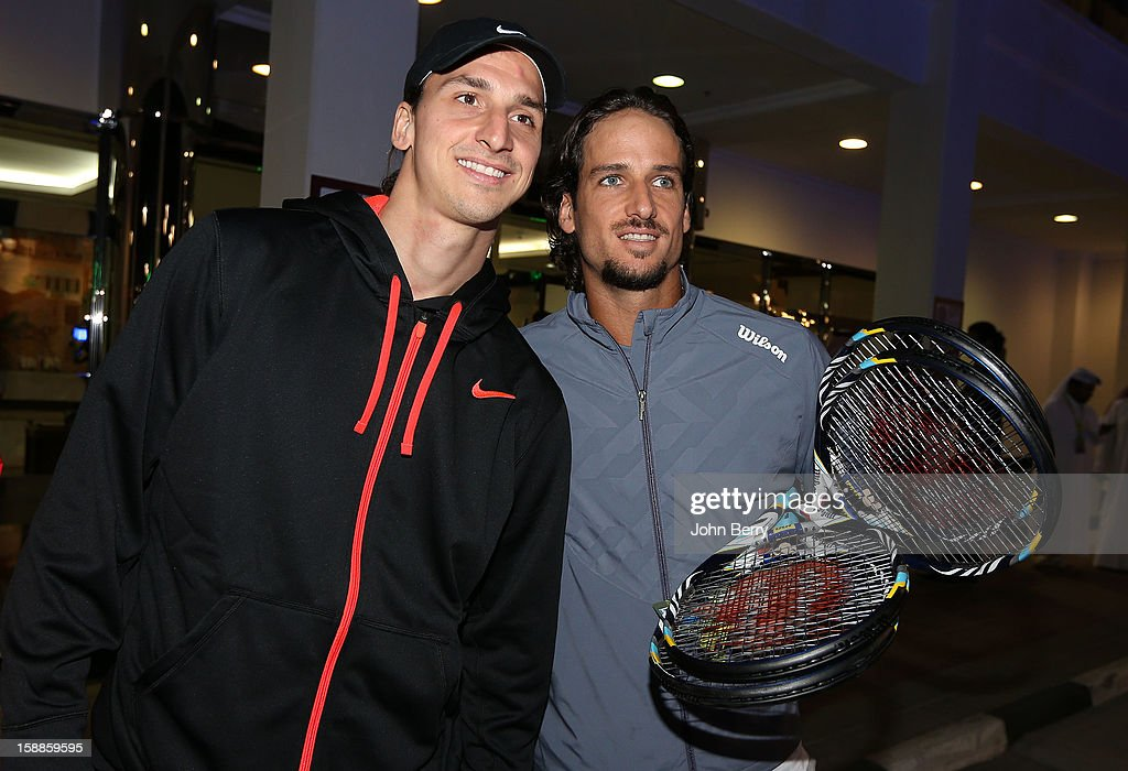 <a gi-track='captionPersonalityLinkClicked' href=/galleries/search?phrase=Zlatan+Ibrahimovic&family=editorial&specificpeople=206139 ng-click='$event.stopPropagation()'>Zlatan Ibrahimovic</a> of PSG poses with tennis player <a gi-track='captionPersonalityLinkClicked' href=/galleries/search?phrase=Feliciano+Lopez&family=editorial&specificpeople=206172 ng-click='$event.stopPropagation()'>Feliciano Lopez</a> of Spain after watching David Ferrer of Spain against Dustin Brown of Germany during their first round match on day two of the Qatar Open 2013 at the Khalifa International Tennis and Squash Complex on January 1, 2013 in Doha, Qatar.