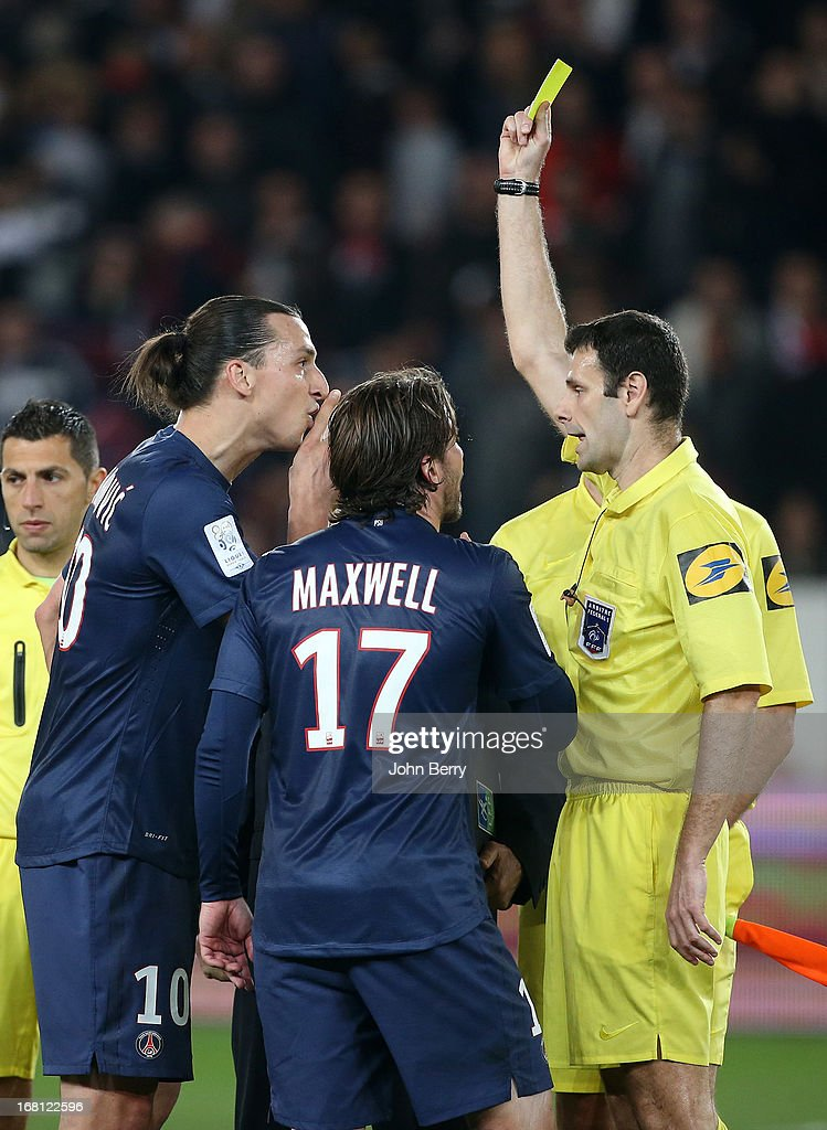 <a gi-track='captionPersonalityLinkClicked' href=/galleries/search?phrase=Zlatan+Ibrahimovic&family=editorial&specificpeople=206139 ng-click='$event.stopPropagation()'>Zlatan Ibrahimovic</a> of PSG receives a yellow card for contestation from referee Alexandre Castro while Maxwell Scherrer comes to his defense at the end of the Ligue 1 match between Paris Saint-Germain FC and Valenciennes FC at the Parc des Princes stadium on May 5, 2013 in Paris, France.