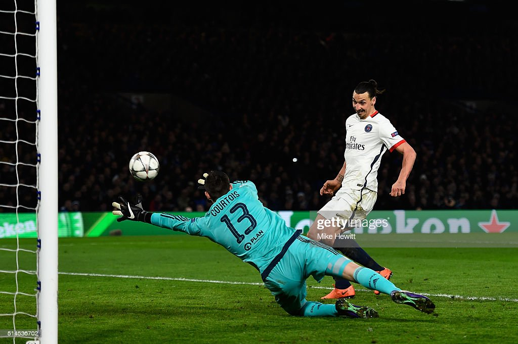 Zlatan Ibrahimovic of PSG scores his team's second goal past goalkeeper Thibaut Courtois of Chelsea during the UEFA Champions League round of 16...