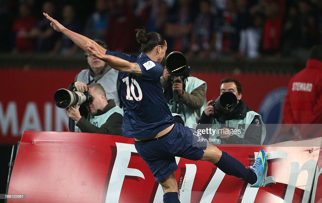 Zlatan Ibrahimovic of PSG shows his frustration by hitting and breaking a billboard after missing a goal during the Ligue 1 match between Paris Saint-Germain FC and Valenciennes FC at the Parc des Princes stadium on May 5, 2013 in Paris, France.