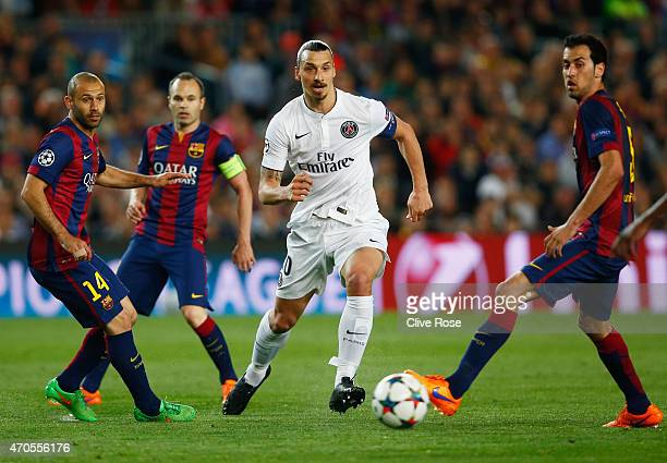Zlatan Ibrahimovic of PSG takes on Javier Mascherano Andres Iniesta and Sergio Busquets of Barcelona during the UEFA Champions League Quarter Final...