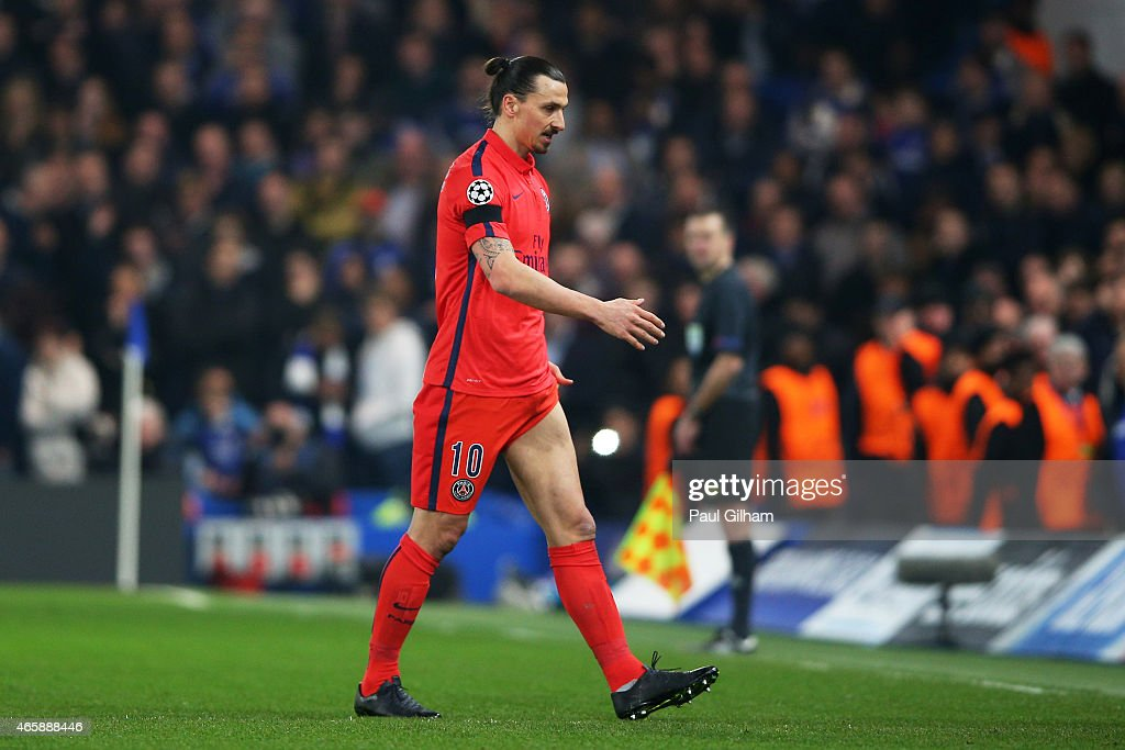 <a gi-track='captionPersonalityLinkClicked' href=/galleries/search?phrase=Zlatan+Ibrahimovic&family=editorial&specificpeople=206139 ng-click='$event.stopPropagation()'>Zlatan Ibrahimovic</a> of PSG walks off the pitch after receiving a straight red card for his tackle on Oscar of Chelsea during the UEFA Champions League Round of 16, second leg match between Chelsea and Paris Saint-Germain at Stamford Bridge on March 11, 2015 in London, England.
