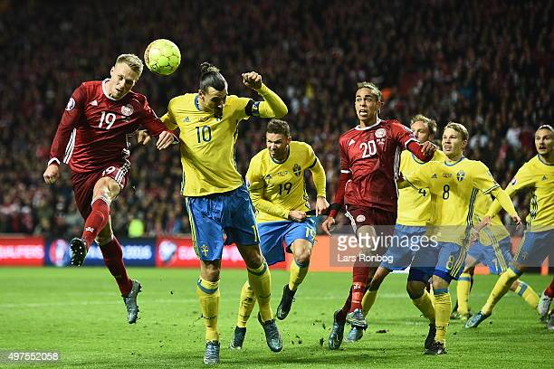 Zlatan Ibrahimovic of Sweden and Nicolai Jorgensen of Denmark compete for the ball during the UEFA EURO 2016 Qualifier PlayOff Second Leg match...