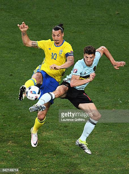 Zlatan Ibrahimovic of Sweden and Thomas Meunier of Belgium challenge for the ball during the UEFA EURO 2016 Group E match between Sweden and Belgium...