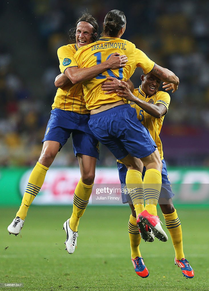 <a gi-track='captionPersonalityLinkClicked' href=/galleries/search?phrase=Zlatan+Ibrahimovic&family=editorial&specificpeople=206139 ng-click='$event.stopPropagation()'>Zlatan Ibrahimovic</a> of Sweden celebrates his goal with Jonas Olsson (L) and <a gi-track='captionPersonalityLinkClicked' href=/galleries/search?phrase=Martin+Olsson&family=editorial&specificpeople=4185617 ng-click='$event.stopPropagation()'>Martin Olsson</a> during the UEFA EURO 2012 group D match between Sweden and France at The Olympic Stadium on June 19, 2012 in Kiev, Ukraine.