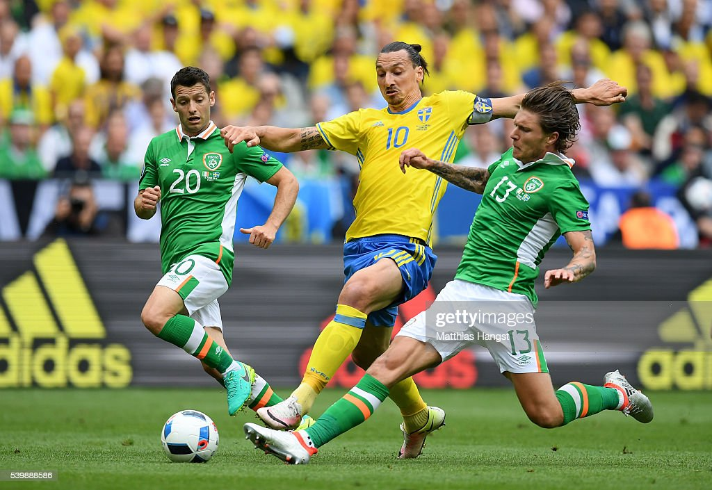 Zlatan Ibrahimovic of Sweden competes for the ball against Wes Hoolahan and Jeff Hendrick of Republic of Ireland during the UEFA EURO 2016 Group E...