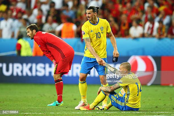 Zlatan Ibrahimovic of Sweden consoles Victor Lindelof of Sweden after defeat in the UEFA EURO 2016 Group E match between Sweden and Belgium at...