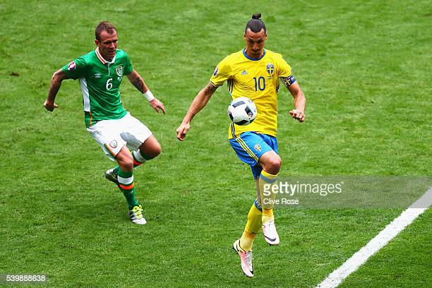 Zlatan Ibrahimovic of Sweden controls the ball under pressure of Glenn Whelan of Republic of Ireland during the UEFA EURO 2016 Group E match between...