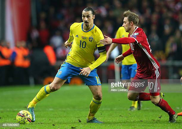 Zlatan Ibrahimovic of Sweden holds off Christian Eriksen of Denmark during the UEFA EURO 2016 Qualifier PlayOff Second Leg match between Denmark and...