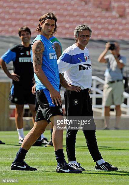 Zlatan Ibrahimovic striker of Inter Milan and coach Jose Mourinho talk as they watch team practice at the Rose Bowl stadium on July 20 2009 in...