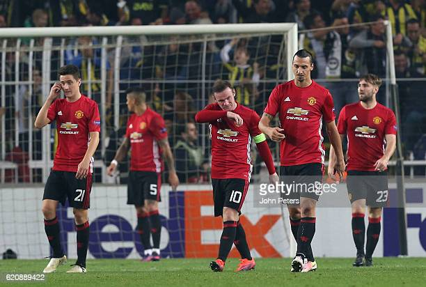Zlatan Ibrahimovic Wayne Rooney and Ander Herrera of Manchester United react to conceding a goal to Jermaine Lens of Fenerbahce during the UEFA...